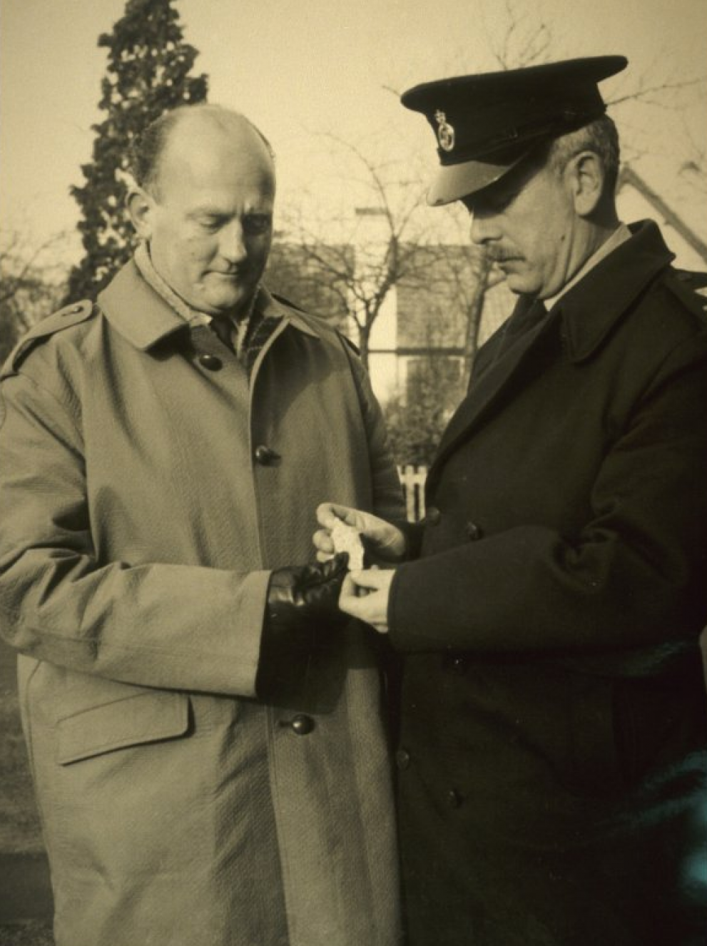 P.C. Scott (right) examining a piece of the Barwell meteorite.